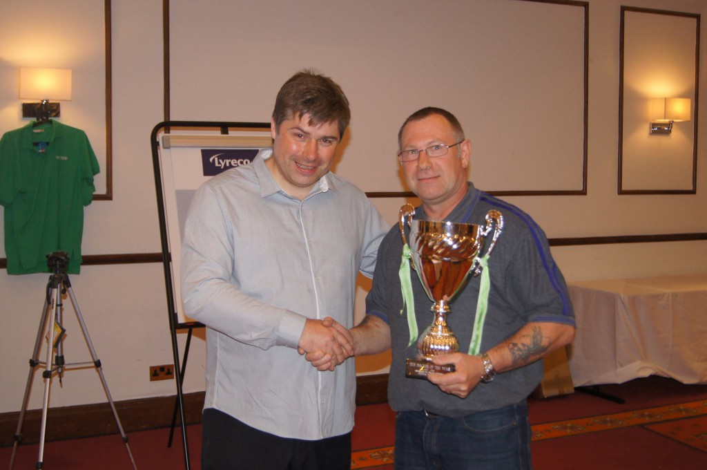 Russell Taylor awards Bruce Copping the Tile Doctor of the Year Award for 2014